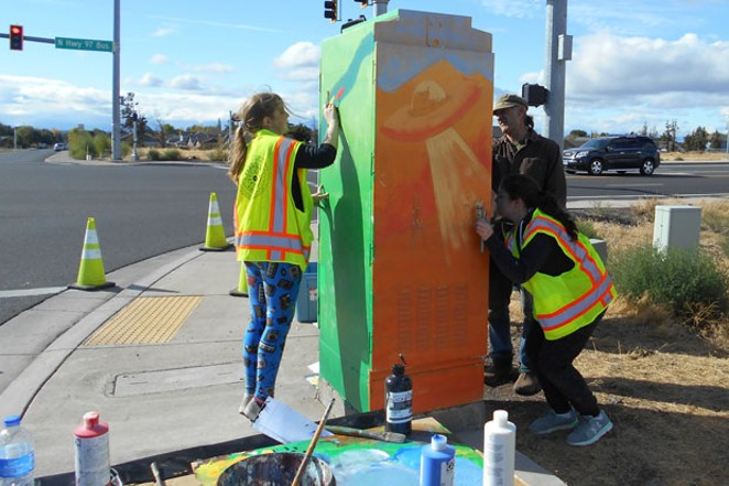 A group of local students paints an electrical box in Redmond. - CITY OF REDMOND