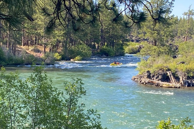 The Big Eddy rapid on the Deschutes River was busy with commercial raft boats on Sunday, July 5. Raft guides and customers wore masks. - LAUREL BRAUNS