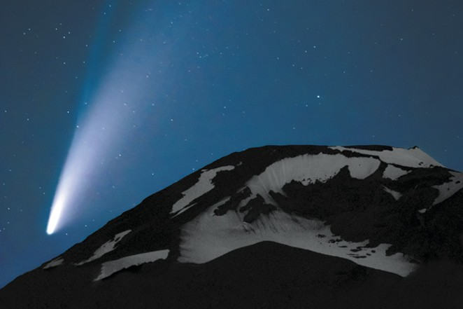 This photo was taken by Wayne Harney on July 16 at 11:30 p.m. near Sparks Lake on Century Drive in Bend. NEOWISE is a three-mile-wide celestial comet visible in Central Oregon since mid-July. It will take 6,800 years to orbit the sun. It has a bright trail of illuminated dust and another trail of ions. When it comes close to the sun, the heat evaporates the comet's ice. Chunks of dust and rocks fly behind, reflecting the sun's light. - WAYNE HARNEY