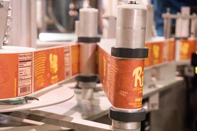 Inside the packaging facility of Riff Cold Brewed Coffee. Paul Evers, Cultivate Bend's board president, 