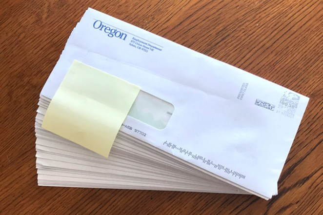 Twenty-seven checks arrived in Jason Brummond's mailbox at the same time last week, adding up to many thousands of dollars from the Oregon Employment Department. - JASON BRUMMOND