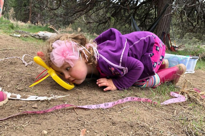 Liv, age 4, enjoys her first adventure via ants coming and going through a magnified looking glass. - COURTESY RAE ALBERG