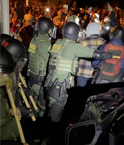In the middle of the melee Wednesday night, as federal agents extracted a driver and two detainees from the ICE bus. - NICOLE VULCAN