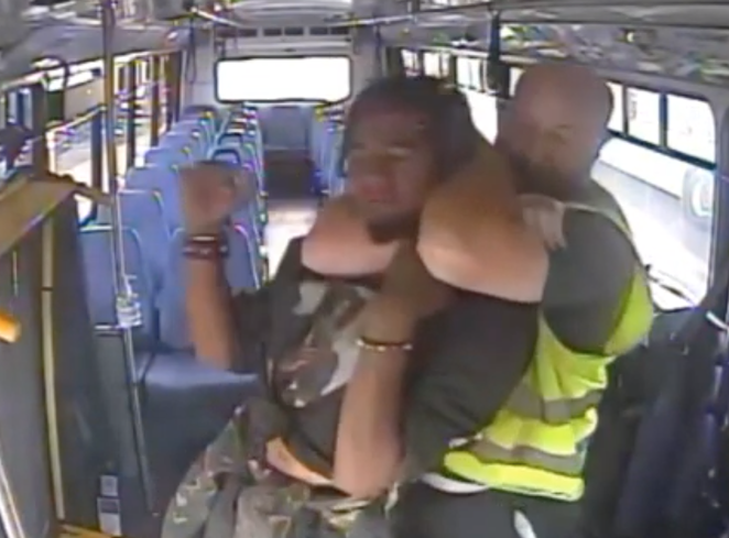 Michael Lee Brinster on the right has Dorian Zane Allstot on the left in a chokehold as he drags him off a Cascades East Transit bus on Aug. 20 for not wearing shoes. - SCREENSHOT VIA FOOTAGE FROM CASCADES EAST TRANSIT