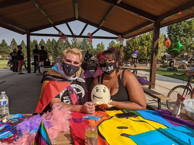 Activists create masks at a crafts table in Pilot Butte Neighborhood Park. - KERSTIN ARIAS