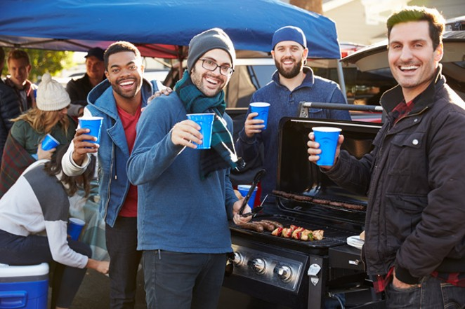 """Take a """"que"""" from these football tailgaters and get your parking-lot hangout game on at Mt. Bachelor this season. - ADOBE STOCK"""