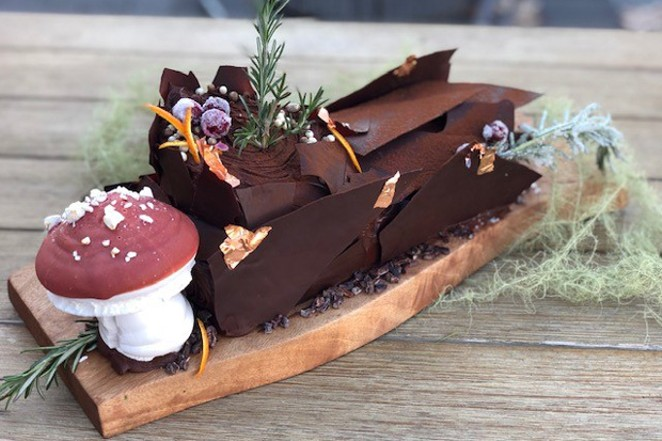 A festively decorated buche de noel from Foxtail Bakeshop. - FOXTAIL BAKESHOP