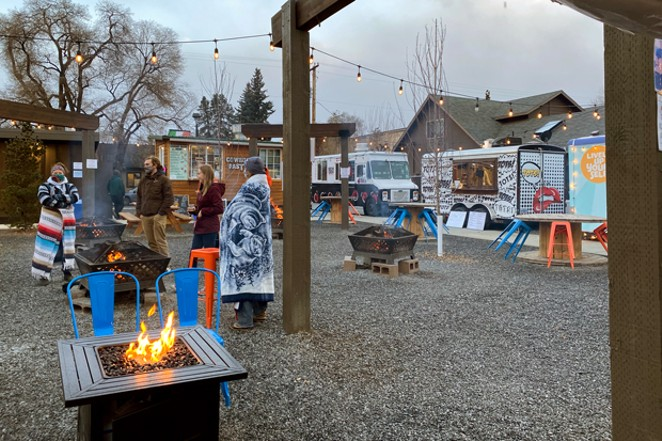 Warm clothing and firepits are a comfy combination at the Midtown Yacht Club. - NICOLE VULCAN