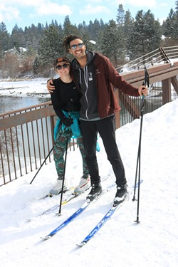 Sophia Blue and Blakelee Evans basking in the snow on skis, right in town. - DAMIAN FAGAN