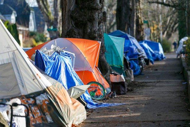 Tents line a sidewalk in Northeast Portland. Legislation proposed by Oregon Democrats would make it easier to approve homeless shelters, and harder to sweep away tent dwellings. - KRISTYNA WENTZ-GRAFF / OPB