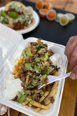 Asada fries offer a switch on the classic nachos. - NICOLE VULCAN