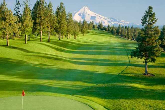 Mountains stand in the distance at River's Edge Golf Course in Bend. The course could be converted into up to 400 homes developed by Pahlisch Homes. - COURTESY VISITBEND
