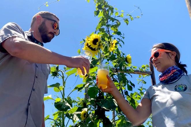 Brewmaster Dustin Kellner, left, with Lisa Sanco, sustainability educator. - CHUCK GREENWOOD