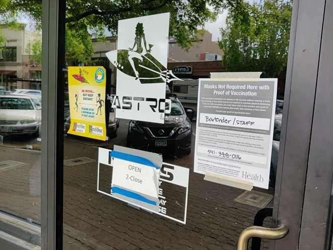 A sign at Astro Lounge in Downtown Bend informs customers that they will allow non-masked patrons after they show proof of vaccination - JACK HARVEL