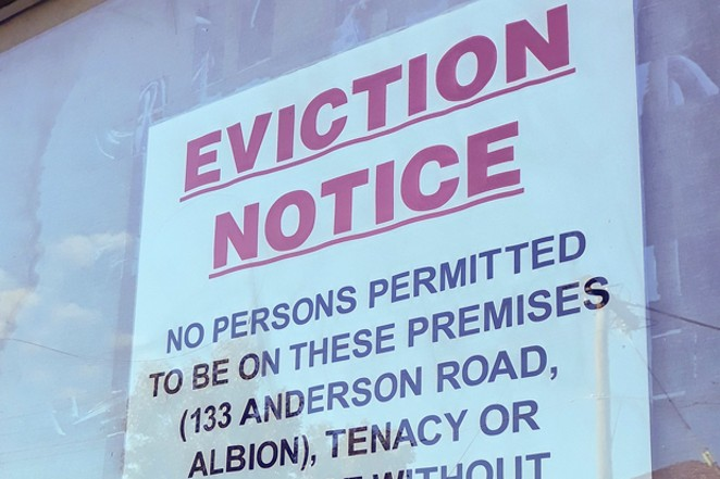 An eviction notice hangs in a window. - COURTESY OF DAVID JACKMANSON