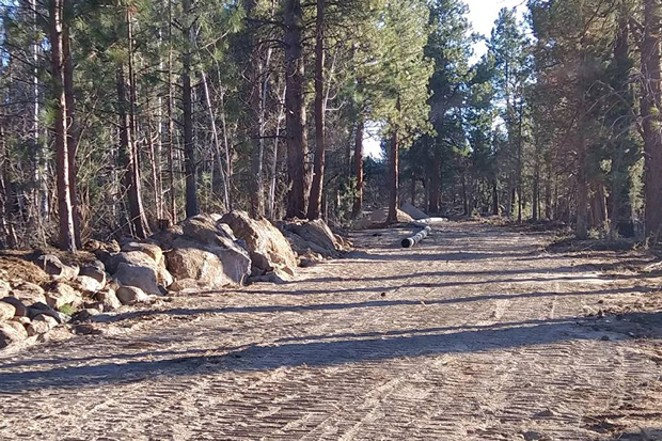 PATRON GROUP IN TUMALO LAWSUIT