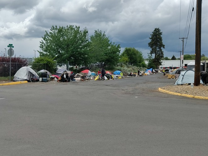 Camps line both sides of Emerson Avenue in Bend. On Wednesday, June 2, Bend City Council adopted policies that set criteria for camp removals in public right of ways. - JACK HARVEL