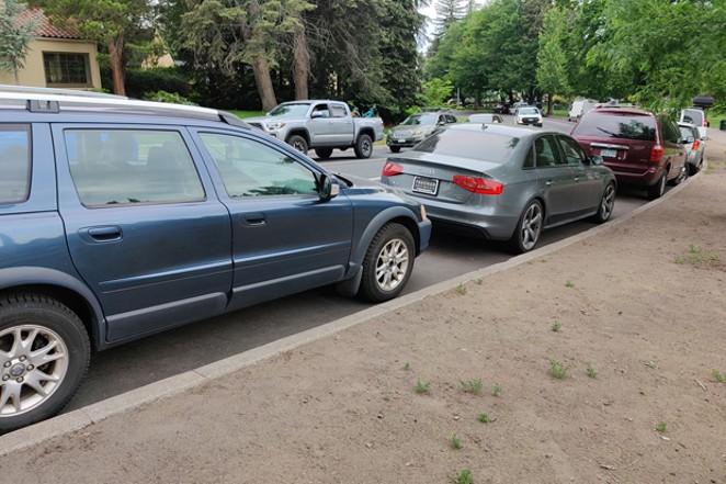Cars are lined up by Drake Park, where time-limited parking is still available to the public. - JACK HARVEL