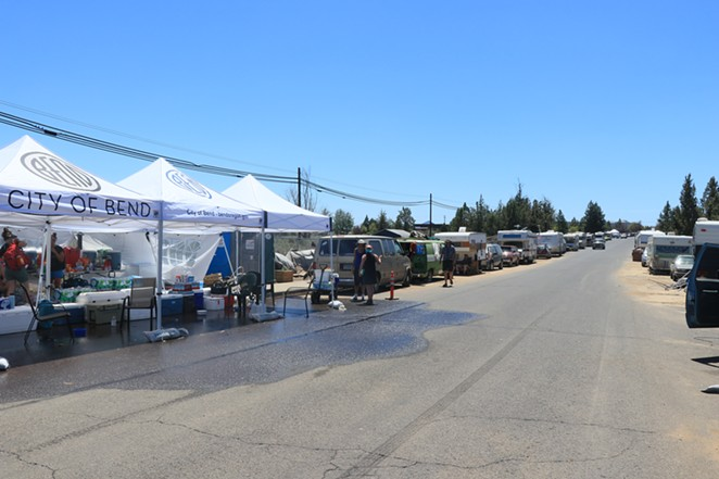 About 80-100 people have set up camp on Hunnell Road in Bend, Oregon. The area is especially susceptible to problems with the heat due to lack of shade and the hot asphalt. - JACK HARVEL