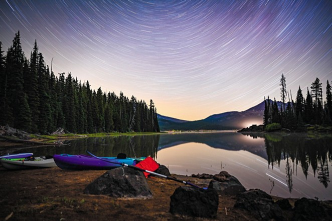 Paddling into my favorite campsite with all the gear - DANNICA WHITE