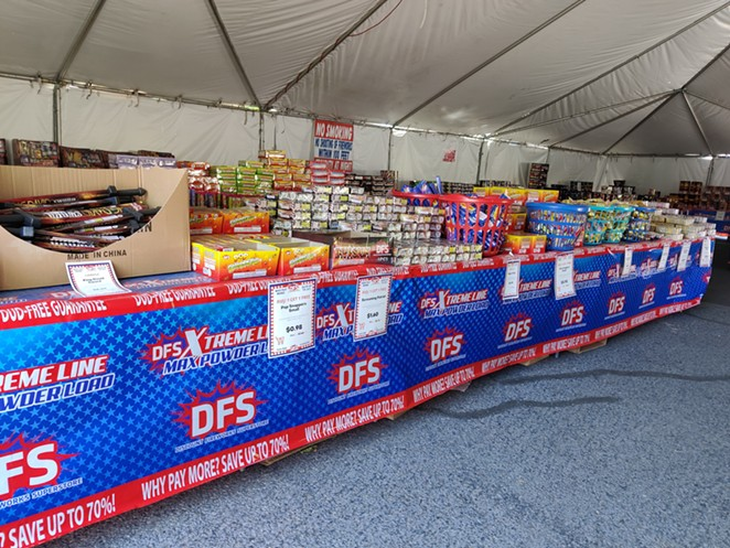 Jake Dennis, who volunteers at Discount Firework Superstore, said business slowed down some after the firework ban went into effect, but also said the customers still buying were buying more. - JACK HARVEL