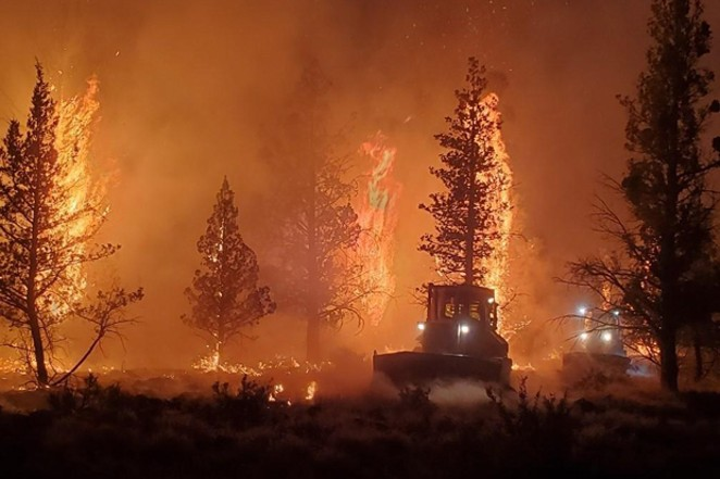 Firefighters worked overnight on Sunday trying to contain the Grandview Fire. - COURTESY INCIWEB
