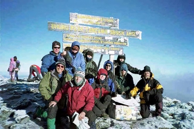 Rasmussen on the summit of Uhuru Peak in Tanzania. Africa's highest point and the world's highest free-standing mountain. - COURTESY JEFF RASMUSSEN