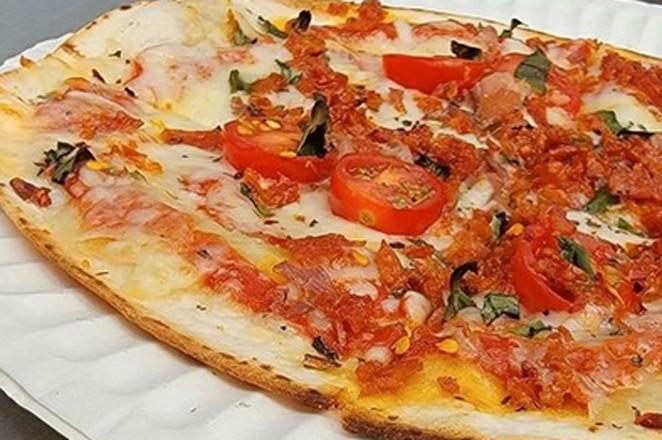 Pizza from @godofpizzabend. - COURTESY GALVESTON STREET MARKET