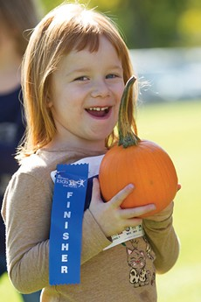 All runners receive a pumpkin at the Kid's Harvest Run at Bend Fall Festival! - BRIAN BECKER
