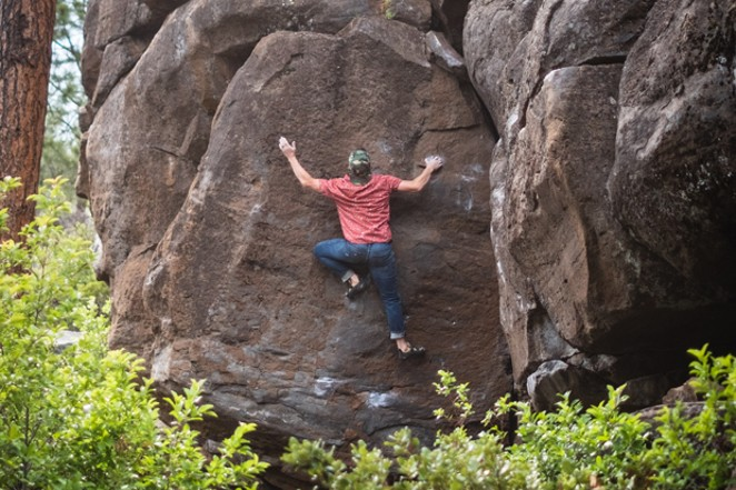 Author Jason Chinchen, of a locals' fan-favorite climbing book, climbs at Widgi Boulders. - FORREST FRANKLIN