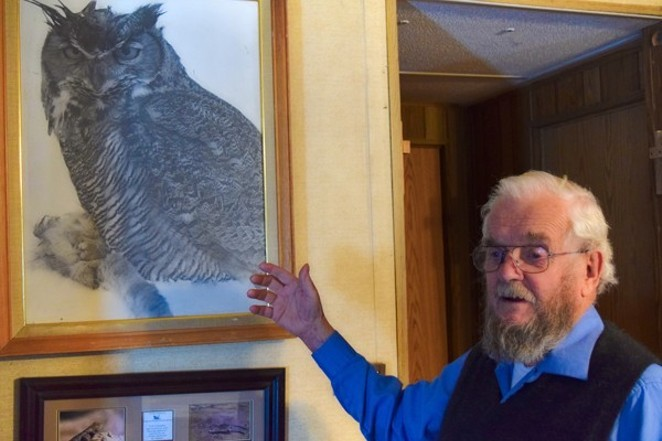 Jim Anderson shows a favorite photograph that he took. - JIM ANDERSON