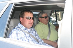 Bend Mayor Casey Roats and Redmond Mayor George Endicott buckle up Wednesday, for Uber's inaugural ride in Central Oregon. Service begins for the public 10 am Thurs., May 4. - NICOLE VULCAN