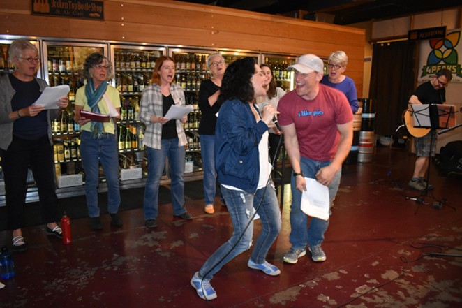 Singers in the Public (Rock) Choir belt one out through smiles of joy. - YOKO IKEDA