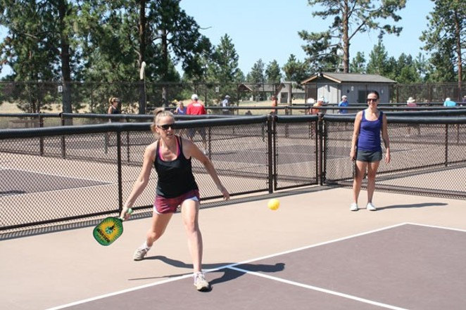 EDITOR NICOLE VULCAN TAKING A SWING AT THE OL' PICKLEBALL