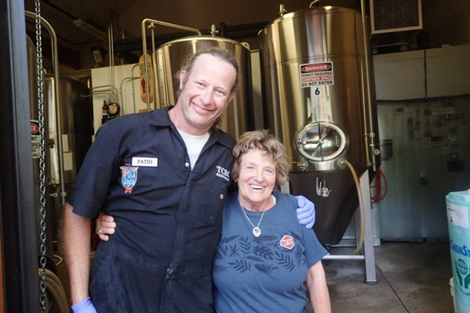 Homebrewer Nancy Noll, right, gets a congratulatory hug from fellow brewer Patio. - SUBMITTED / THREE CREEKS BREWING