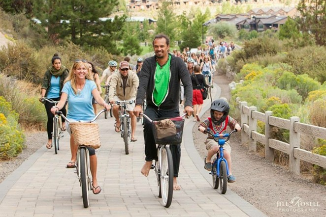 Amanda Stuermer, World Muse Director, and Michael Franti lead the pack on a past Soulrocker bike ride. Photo by Jill Rosell. - JILL ROSELL