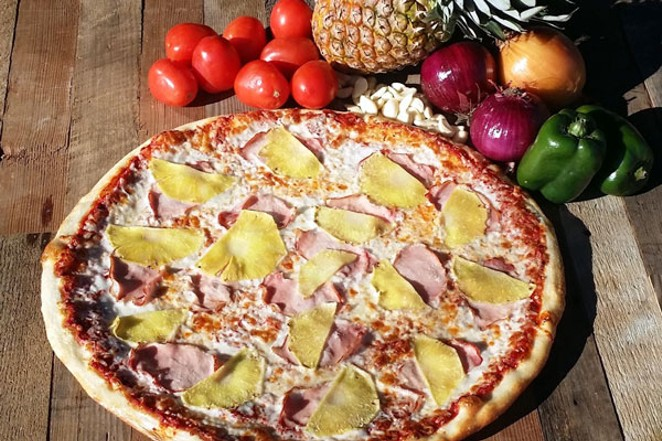 A teenager's fantasy... pineapple on pizza. - BEND PIZZA KITCHEN