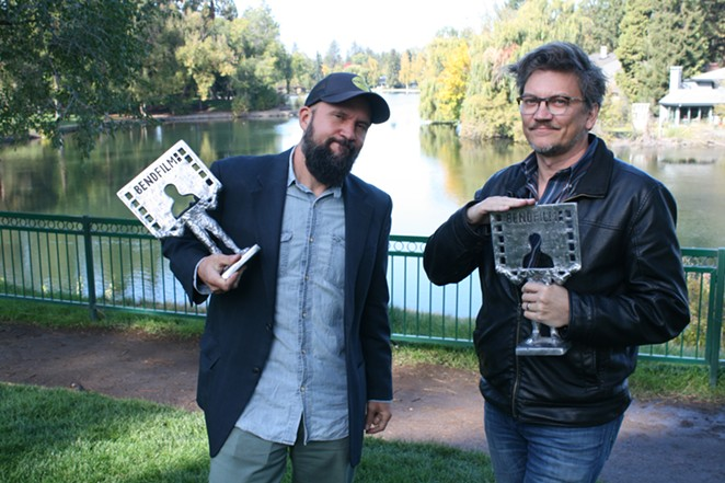 Festival Director Todd Looby and Festival Programmer Erik Jambor get silly with BendFilm's award statues during our interview in Bend's Drake Park. - NICOLE VULCAN