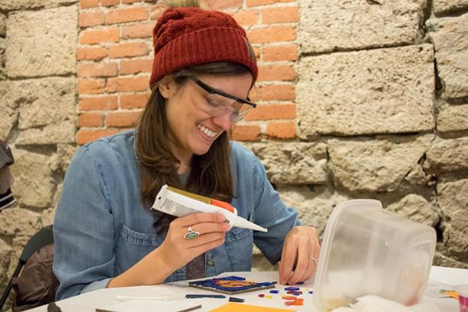Director Sofia Kruz creates a tile during a recent mosaic workshop. - KEELY DAMARA