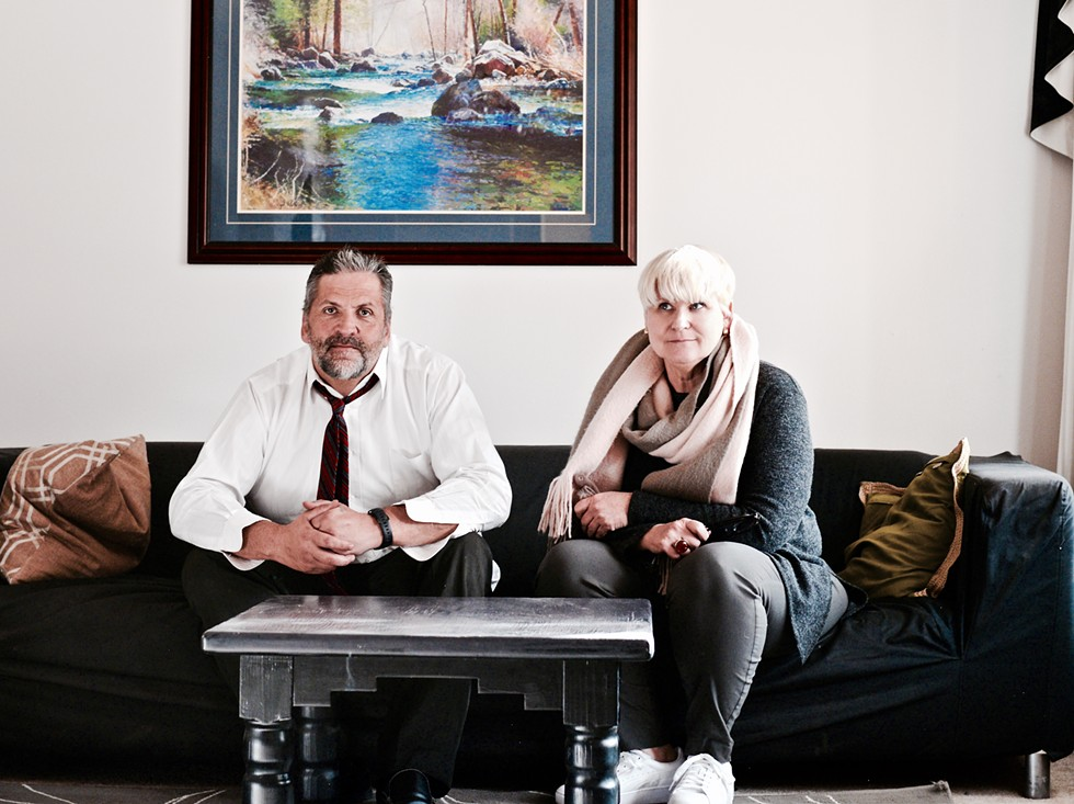 Gene Gammond and Sally Pfeifer sit in one of their transitional homes, in Bend, Oregon. They're leading the charge on re-thinking housing options for those in recovery from drug and substance abuse and those who have been recently released from jail. - MAGDALENA BOKOWA
