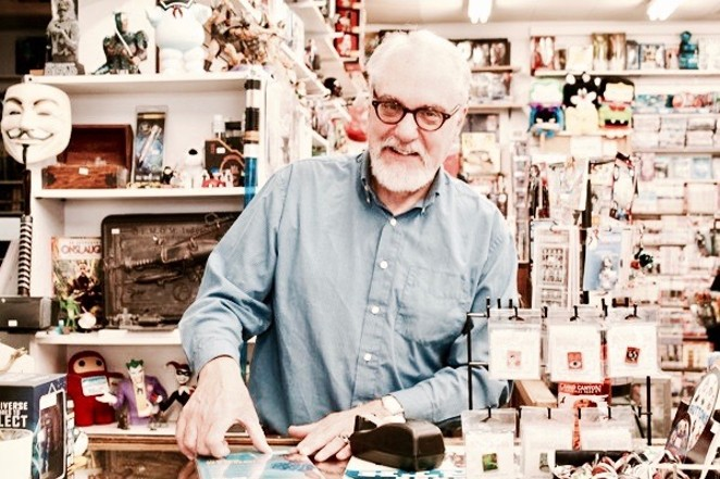 Duncan McGeary stands in his shop Pegasus Books in downtown Bend, Oregon. - JUDY STIEGLER
