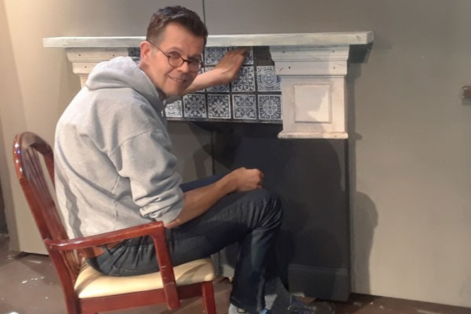"""Aethetist Bill Alsdurf places tiles on the set for """"A Christmas Carol,"""" opening at the Cascades Theatre Dec 1. - ELIZABETH WARNIMONT"""