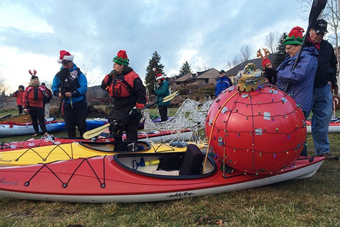 Gaggles of holiday celebrants gather with battery powered lights and parade vessels to charge the 2017 Holiday Lights Winter Paddle Parade. - COURTESY TUMALO CREEK KAYAK & CANOE
