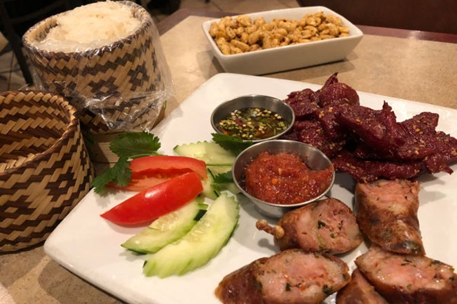 Tantilizing beef and pork sausage, with crispy peanuts, make for a delictable treat at Nam Tok Kitchen. - LISA SIPE