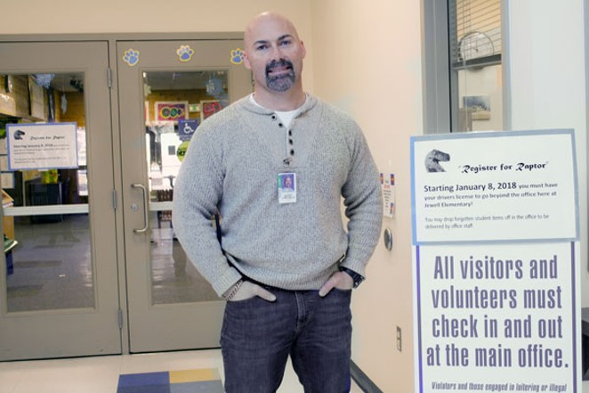 Principal Scott Edmondson stands in the secure lobby at R.E. Jewell Elementary School in southeast Bend. - CHRIS MILLER