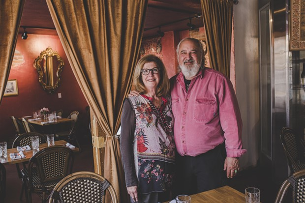 French Market owners Judy and Phil Lipton in the French-inspired dining room. - TAMBI LANE