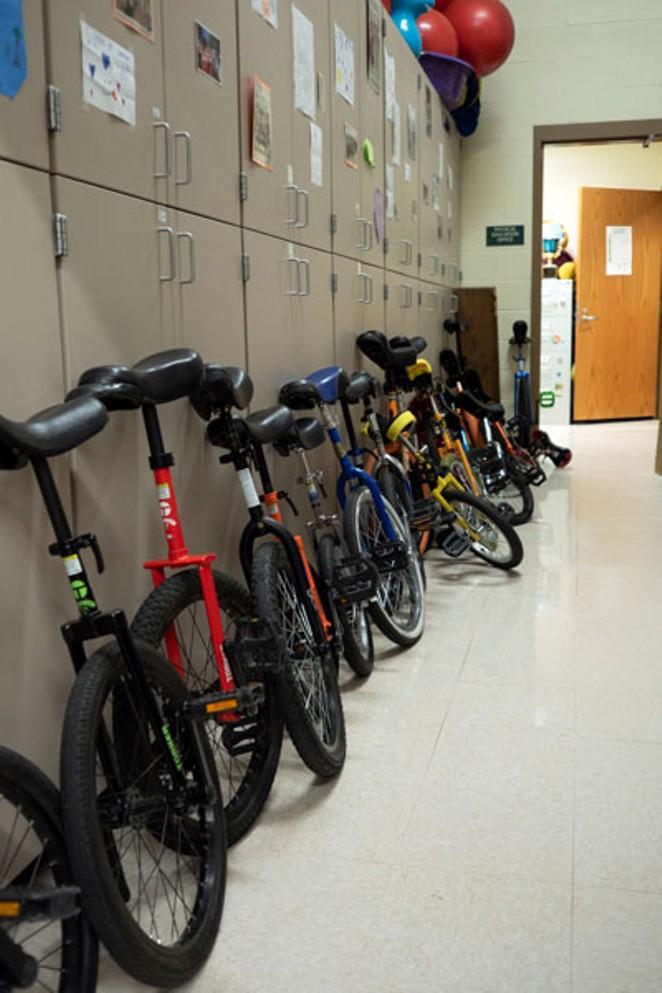 The unicycle-stocked hallway at Pine Ridge Elementary. - CHRIS MILLER