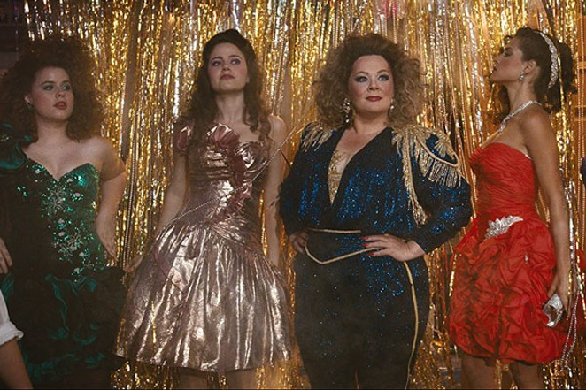Melissa McCarthy and friends showing how to rock an '80s party. - WARNER BROS