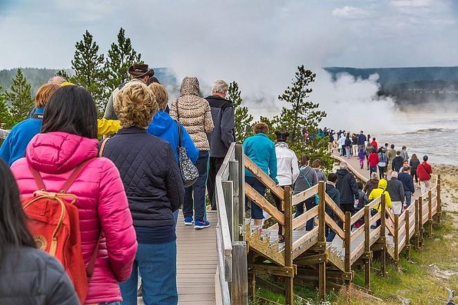 The crowded boardwalk in the lower Geyser Basin. - WIKIMEDIA