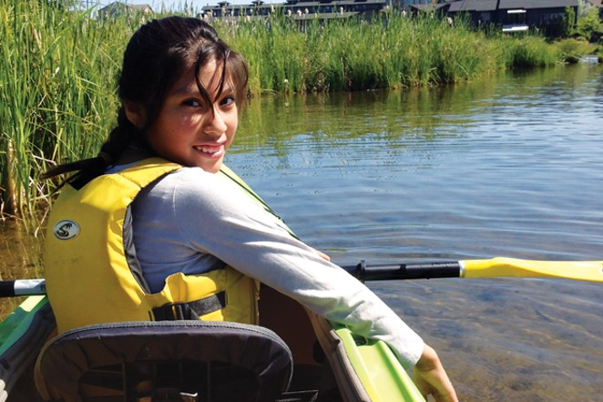 Nancy Gonzalez bravely navigating the Deschutes River. - K.M. COLLINS